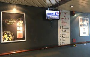 CorsicaCom-Agence média-régie publicitaire-publicité Corse affiche Jean Nicoli écran
